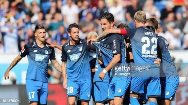 Dennis Geiger of Hoffenheim celebrates after scoring his team`s first goal during the Bundesliga match between TSG 1899 Hoffenheim and FC Schalke 04...