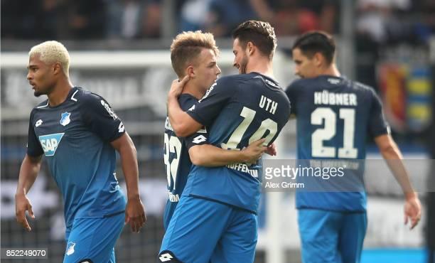 Dennis Geiger of Hoffenheim celebrates his goal to machete 10 with Mark Uth of Hoffenheim during the Bundesliga match between TSG 1899 Hoffenheim and...