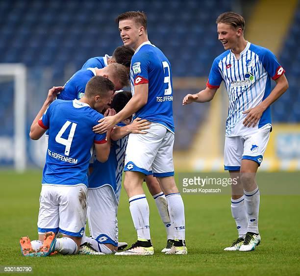 Dennis Geiger of Hoffenheim celebrates his team's third goal with team mates during the German U19 Championship Semi Final First Leg match between...