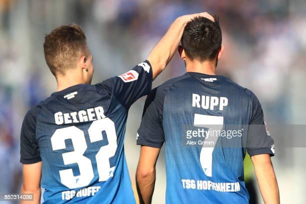 Dennis Geiger of Hoffenheim celebrates with goal scorer Lukas Rupp of Hoffenheim after he scored to make it 20 during the Bundesliga match between...