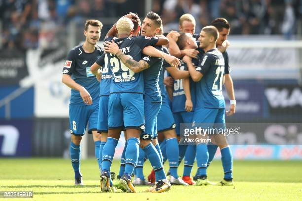 Dennis Geiger of Hoffenheim celebrates with his team mates after he scored to make it 10 during the Bundesliga match between TSG 1899 Hoffenheim and...