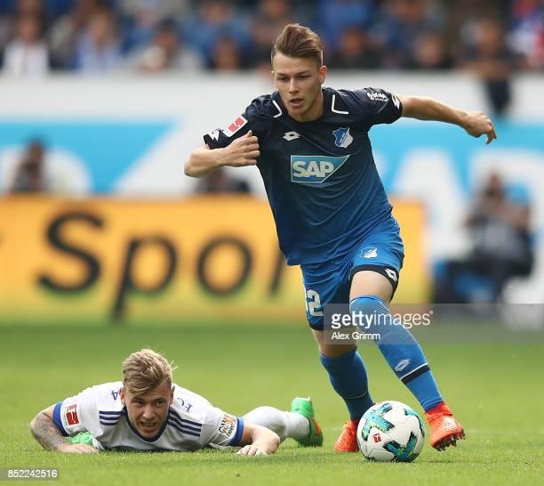Dennis Geiger of Hoffenheim fights for the ball with Maximilian Meyer of Schalke during the Bundesliga match between TSG 1899 Hoffenheim and FC...