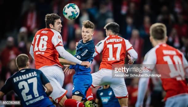 Dennis Geiger of Hoffenheim in action against Stefan Bell of Mainz during to the Bundesliga match between 1 FSV Mainz 05 and TSG 1899 Hoffenheim at...