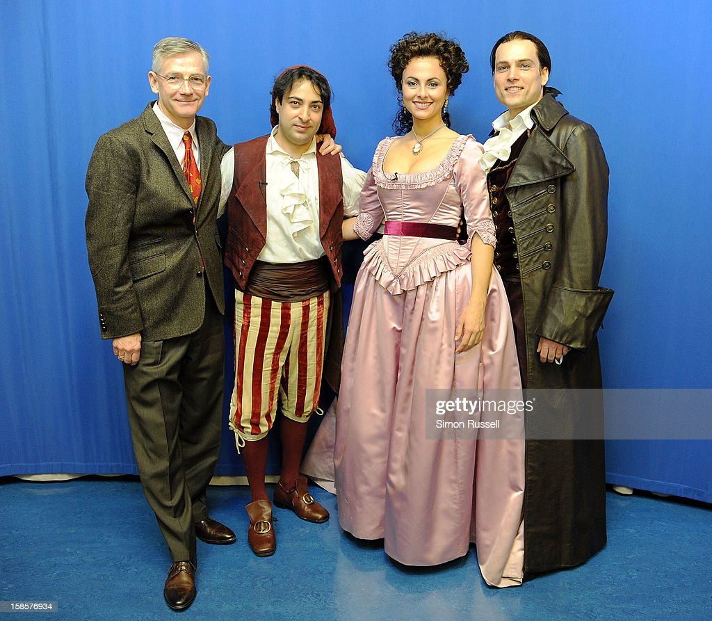 Dennis Giauque assistant director of Music at the MET with Metropolitan Opera stars Rodion Pogossov, Isabel Leonard and Alek Shrader perform 'The Barber Of Seville' at the Kravis Children's Hospital at Mount Sinai Medical Center on December 19, 2012 in New York City.