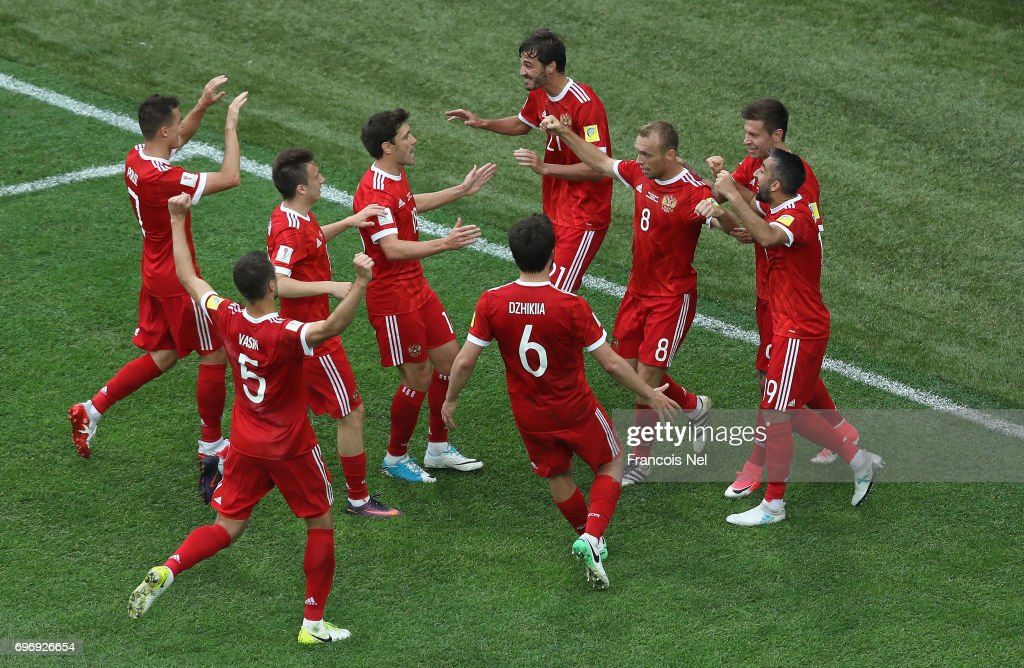 Dennis Glushakov of Russia celebrates scoring his sides first goal with his Russia team mates during the FIFA Confederations Cup Russia 2017 Group A match between Russia and New Zealand at Saint Petersburg Stadium on June 17, 2017 in Saint Petersburg, Russia.