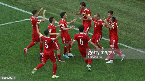Dennis Glushakov of Russia celebrates scoring his sides first goal with his Russia team mates during the FIFA Confederations Cup Russia 2017 Group A...