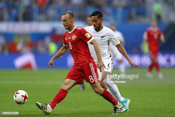 Dennis Glushakov of Russia is put under pressure from Bill Tuiloma of New Zealand during the FIFA Confederations Cup Russia 2017 Group A match...