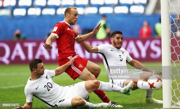 Dennis Glushakov of Russia scores his sides first goal during the FIFA Confederations Cup Russia 2017 Group A match between Russia and New Zealand at...