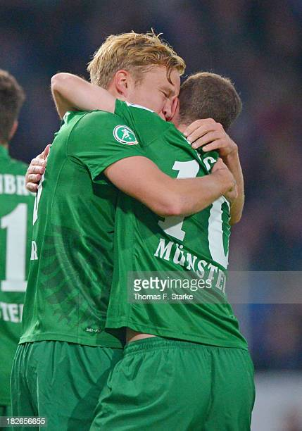 Dennis Grote and Amaury Bischoff of Muenster celebrate their teams first goal during the Third League match between between VfL Osnabrueck and...