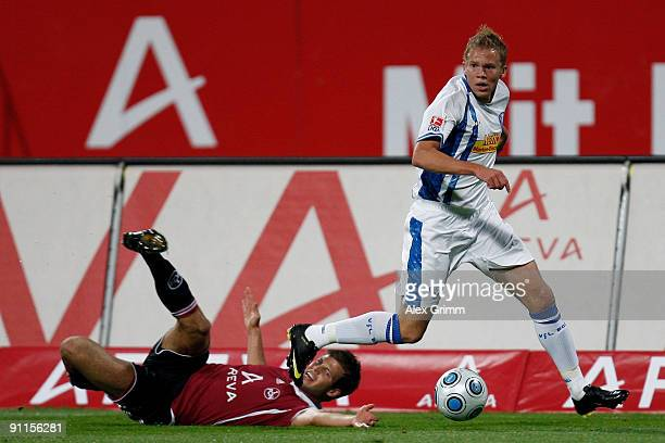 Dennis Grote of Bochum eludes Dennis Diekmeier of Nuernberg during the Bundesliga match between 1 FC Nuernberg and VfL Bochum at the Easy Credit...