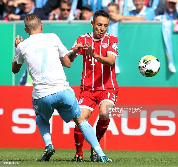Dennis Grote of Chemnitz and Rafinha of Bayern Muenchen battle for the ball during the DFB Cup first round match between Chemnitzer FC and FC Bayern...