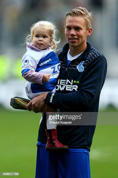 Dennis Grote of Duisburg and his daughter celebrate the 20 victory after the third League match between MSV Duisburg and RW Erfurt at...