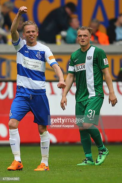Dennis Grote of Duisburg celebrates the first goal and Thorsten Schulz of Muenster looks dejected during the Third League match between MSV Duisbrug...
