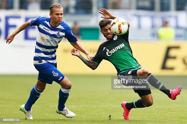 Dennis Grote of MSV Duisburg fouls Junior Caicara of FC Schalke 04 during the DFB Cup match between MSV Duisburg and FC Schalke 04 held at...