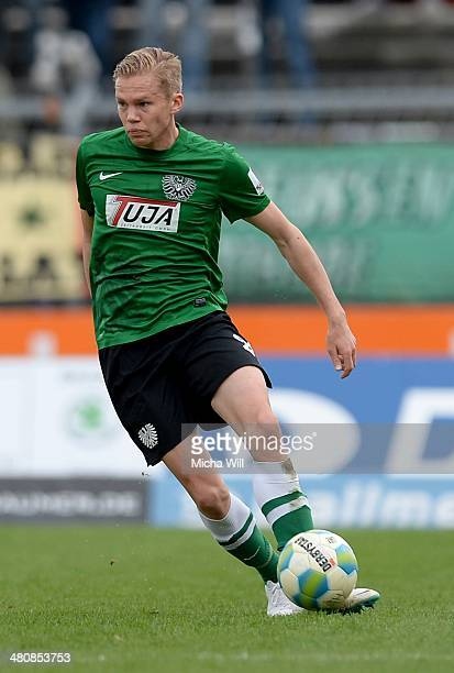 Dennis Grote of Muenster controles the ball during the Third League match between Jahn Regensburg and Preussen Muenster at Jahnstadion on March 22...