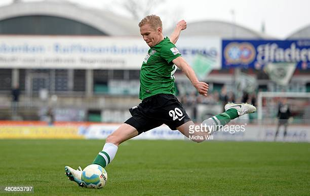 Dennis Grote of Muenster kicks the ball during the Third League match between Jahn Regensburg and Preussen Muenster at Jahnstadion on March 22 2014...