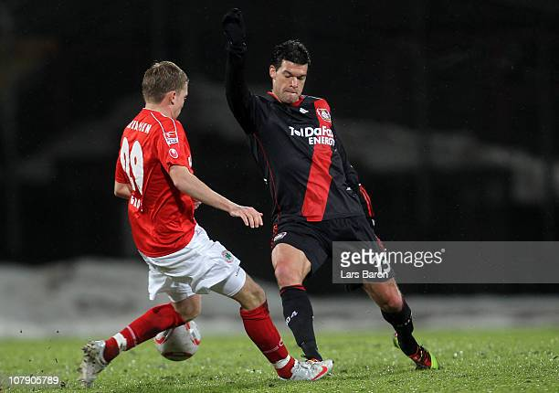 Dennis Grote of Oberhausen challenges Michael Ballack of Leverkusen during the friendly match between RotWeiss Oberhausen and Bayer Leverkusen at...
