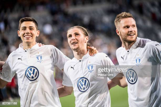 Dennis Hadzikadunic Pawel Cibicki and Anders Christiansen of Malmo FF celebrates after there team´s victory during the Allsvenskan match between...