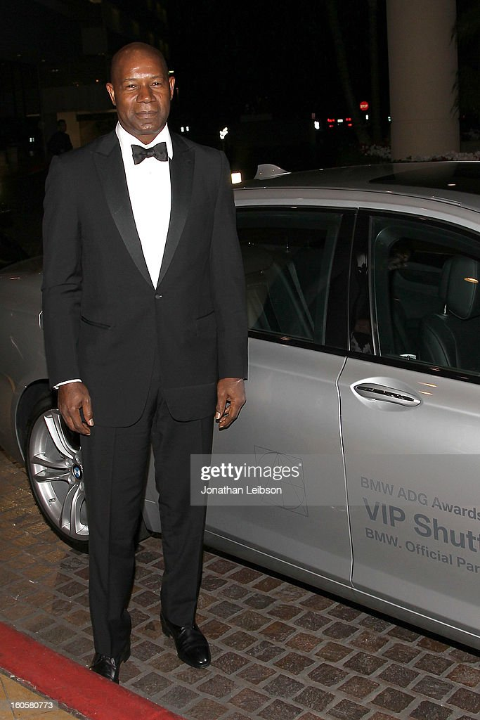 <a gi-track='captionPersonalityLinkClicked' href=/galleries/search?phrase=Dennis+Haysbert&family=editorial&specificpeople=212993 ng-click='$event.stopPropagation()'>Dennis Haysbert</a> arriving in a BMW 7 Series to the 17th Annual Art Directors Guild Awards For Excellence In Production Design presented by BMW at The Beverly Hilton Hotel on February 2, 2013 in Beverly Hills, California.