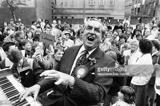 Dennis Healey canvassing votes for the Labour Party by playing the piano at Huddersfield Town Hall Yorkshire