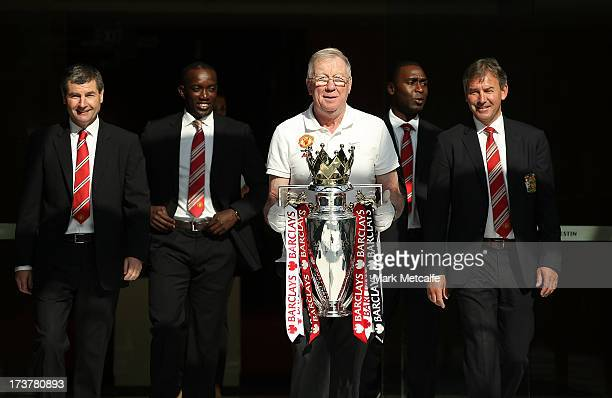 Dennis Irwin Dwight Yorke Andy Cole and Bryan Robson arrive with the Barclays Premier League trophy during the official Manchester United official...