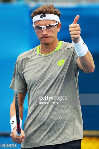 Dennis Istomin of Uzbekistan celebrates victory in his second round match against Marin Cilic of Croatia during day four of the 2014 Sydney...
