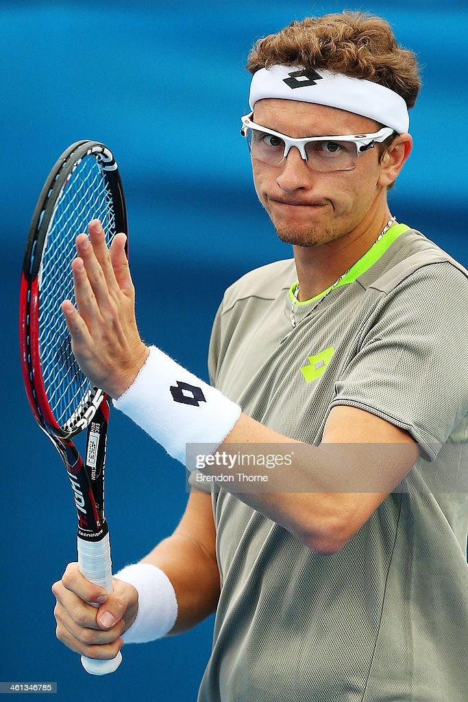 Dennis Istomin of Uzbekistan celebrates victory in his second round match against Marin Cilic of Croatia during day four of the 2014 Sydney International at Sydney Olympic Park Tennis Centre on January 8, 2014 in Sydney, Australia.