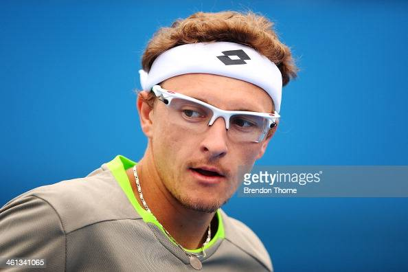 Dennis Istomin of Uzbekistan looks on in his second round match against Marin Cilic of Croatia during day four of the 2014 Sydney International at...