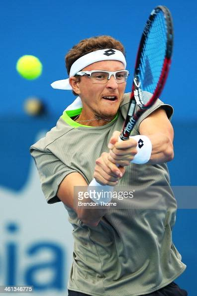 Dennis Istomin of Uzbekistan plays a backhand in his second round match against Marin Cilic of Croatia during day four of the 2014 Sydney...