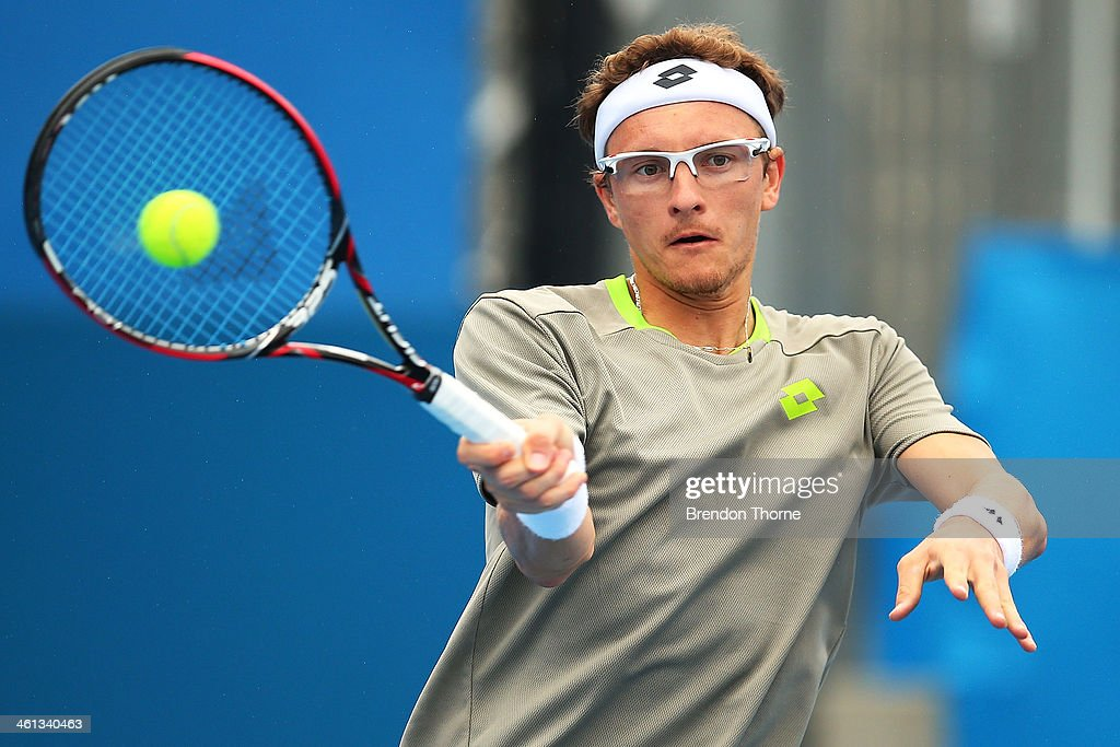 Dennis Istomin of Uzbekistan plays a forehand in his second round match against Marin Cilic of Croatia during day four of the 2014 Sydney International at Sydney Olympic Park Tennis Centre on January 8, 2014 in Sydney, Australia.