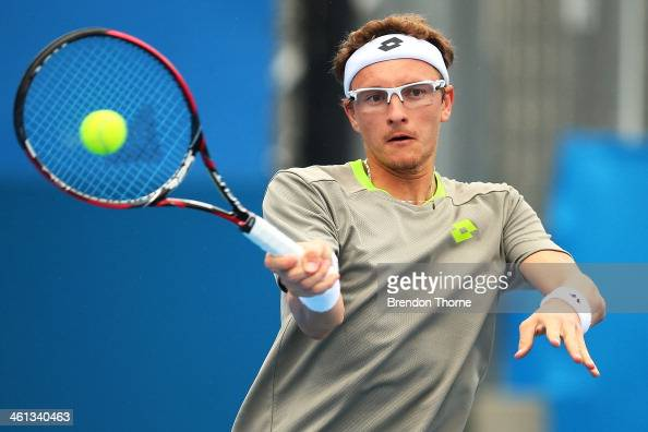 Dennis Istomin of Uzbekistan plays a forehand in his second round match against Marin Cilic of Croatia during day four of the 2014 Sydney...