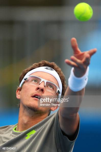 Dennis Istomin of Uzbekistan serves in his second round match against Marin Cilic of Croatia during day four of the 2014 Sydney International at...