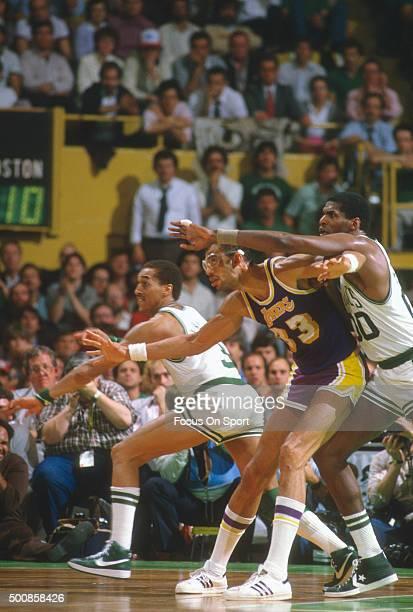 Dennis Johnson and Robert Parish of the Boston Celtics double teams Kareem AbdulJabbar of the Los Angeles Lakers during an NBA basketball game circa...