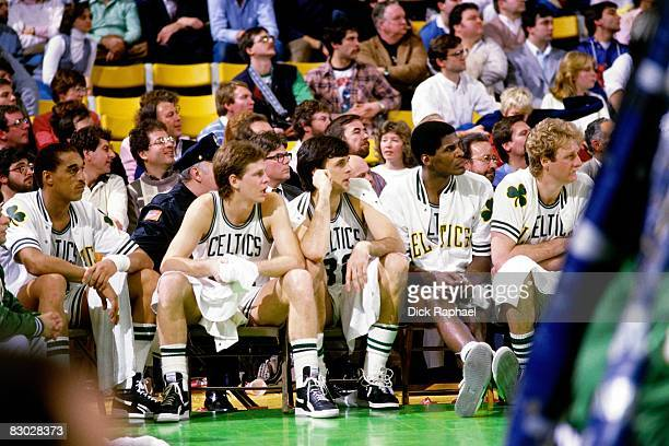 Dennis Johnson Danny Ainge Kevin McHale Robert Parish and Larry Bird of the Boston Celtics watch from the bench against the Los Angeles Lakers circa...