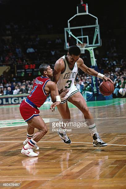 Dennis Johnson of the Boston Celtics drives against Muggsy Bogues of the Washington Bullets during a game circa 1988 at the Boston Garden in Boston...