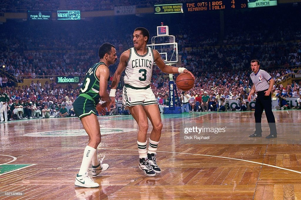 Dennis Johnson #3 of the Boston Celtics moves the ball against John Lucas #10 of the Milwaukee Bucks during a game played in 1987 at the Boston Garden in Boston, Massachusetts.