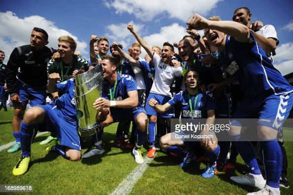 Dennis Kempe celebrates with Karlsruher SC team mates with the trophy after the third Bundesliga match between SV Wehen Wiesbaden and Karlsruher SC...