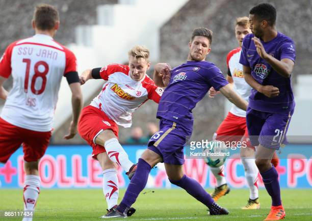 Dennis Kempe of Aue challenges Joshua Mees of Regensburg during the Second Bundesliga match between FC Erzgebirge Aue and SSV Jahn Regensburg at...