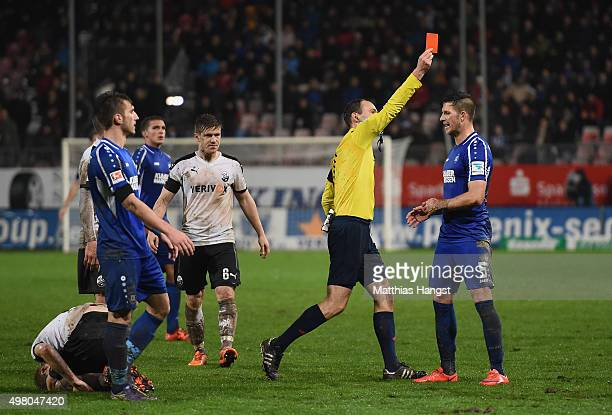 Dennis Kempe of Karlsruhe is shown a yellowred card by referee Bastian Dankert during the Second Bundesliga match between SV Sandhausen and...