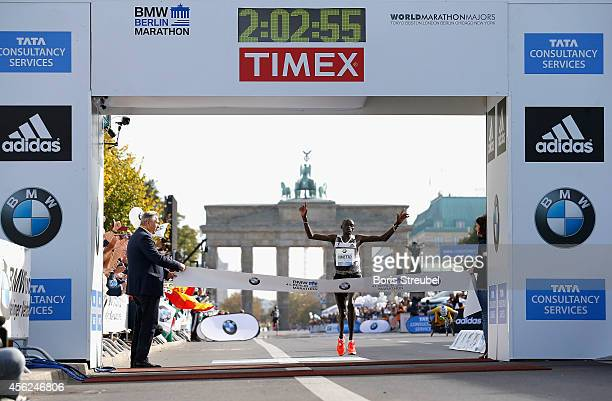 Dennis Kimetto of Kenya crosses the finish line in new world record time during the 41th BMW Berlin Marathon on September 28 2014 in Berlin Germany