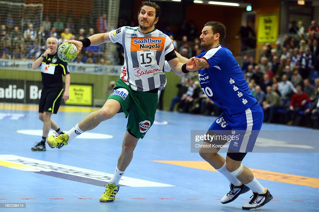Dennis Krause of Gummersbach (R) defends against Michael Haass of Goeppingen (L) during the DKB Handball Bundesliga match between VfL Gummersbach and FrischAuf Goeppingen at Eugen-Haas-Sporthalle on February 20, 2013 in Gummersbach, Germany.