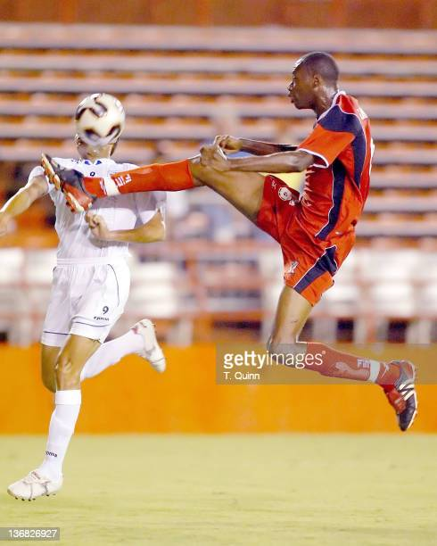Dennis Lawrence of Trinidad attempts to kick the ball from the head of JoseRanirez during a match at the Orange Bowl Miami Florida July 7 2005 The...
