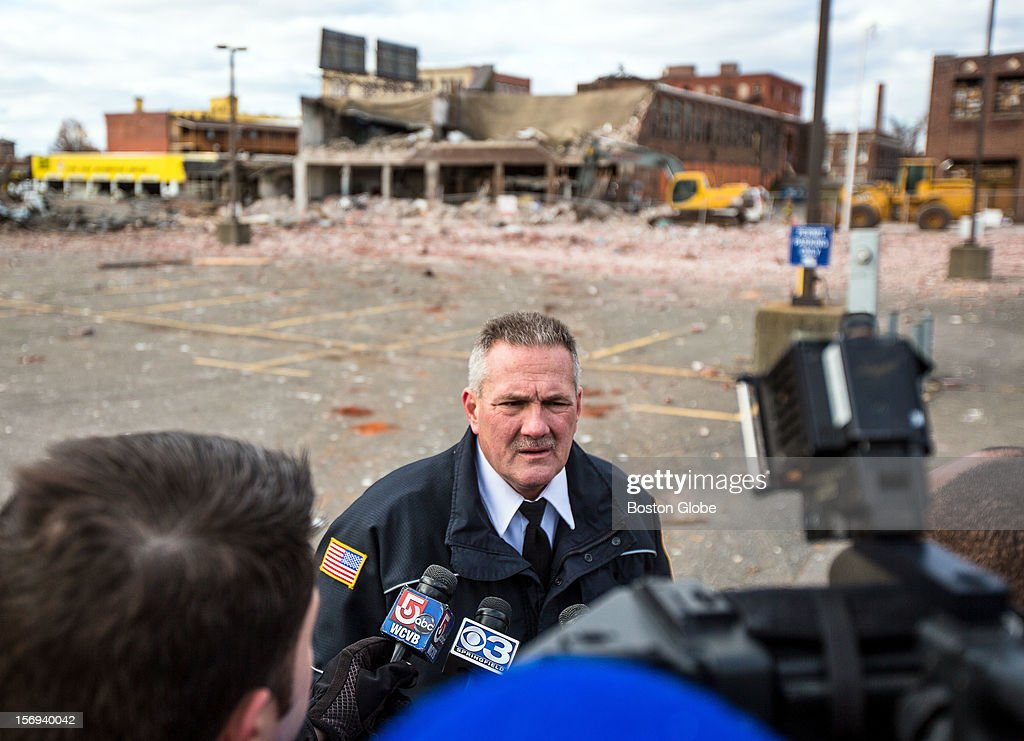 Dennis Leger, Aide to the Fire Commissioner of Springfield, spoke the media at the scene of a natural gas explosion that leveled Scores Gentleman's Club and damaged several nearby buildings on Worthington Street in Springfield.