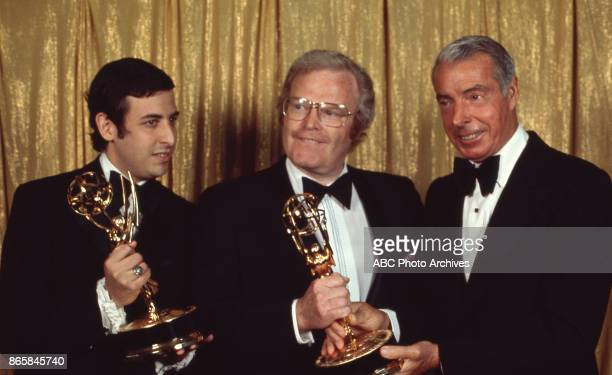 Dennis Lewin Roone Arledge and Joe Dimaggio holding their Emmy Awards in the press room at The 24th Primetime Emmy Awards on May 6 1972 at Pantages...