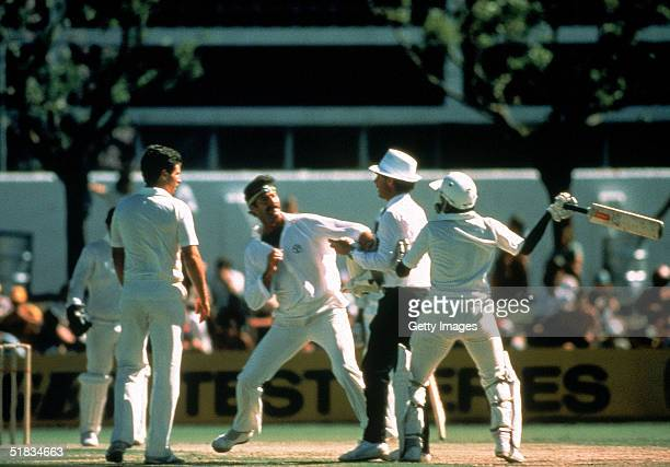 Dennis Lillee of Australia and Javed Miandad of Pakistan have a coming together after a incident on the field during the First Test match between...