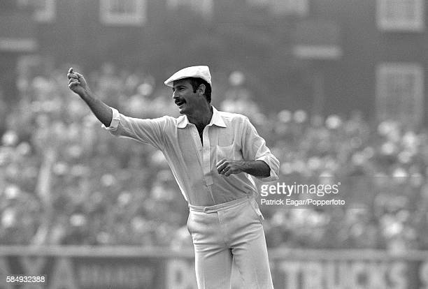 Dennis Lillee of Australia plays to the crowd while wearing umpire Dickie Bird's white cap during the 6th Test match between England and Australia at...