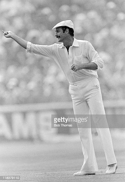 Dennis Lillee of Australia wearing Dickie Bird's white cap impersonates the umpire by gesturing to the crowd during the 6th Test match against...