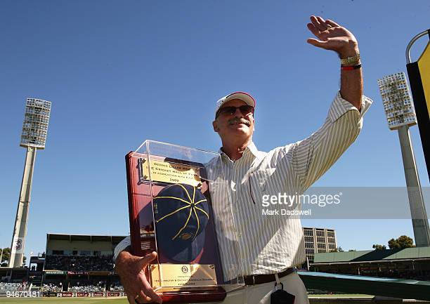 Dennis Lillee shows his ICC Hall of Fame Cap to the crowd during day two of the Third Test match between Australia and the West Indies at WACA on...