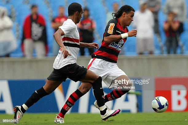 Dennis Marques of Flamengo fights for the ball with Richarlison of Sao Paulo during a match as part of the Brazilian Championship at Maracana Stadium...