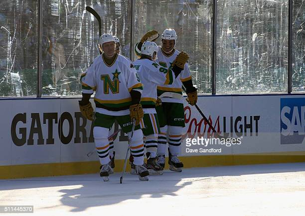 Dennis Maruk of the Minnesota North Stars Alumni celebrates his goal with teammate Andrew Brunette of the Minnesota Wild/North Stars Alumni during...